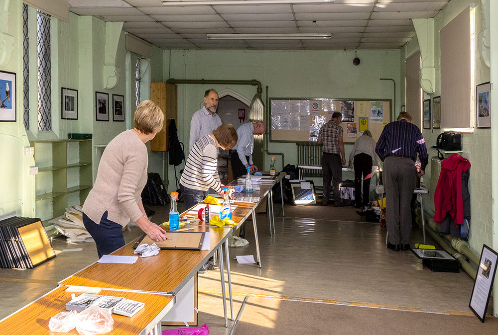 Committee Members Framing pictures at St Barnabas Community Hall